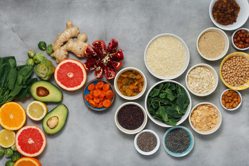 Clean eating concept. Set healthy food - different vegetables and fruits, superfood, seeds, cereal, leaf vegetable on light background, top view. Flat lay