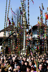 People attend a contest of the traditional palms, largest handmade pales made of wicker things and decorated with colourful flowers and ribbons during Catholic Palm Sunday procession in Lipnica Murowana