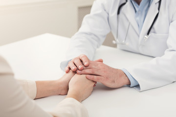 Closeup of patient and doctor hands