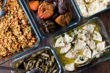 Turkish Food with Olive Oil Kisir, Dolma, Artichoke, Broad Beans and Carrot Salad with Yogurt.