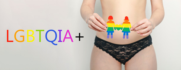 Woman in black lingerie with lgbt symbol, gay emblem
