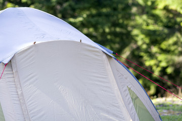Close-up view of part of a tourist tent. Hikers camp detail.