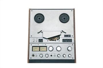 Old reel tape recorder isolated on a white background
