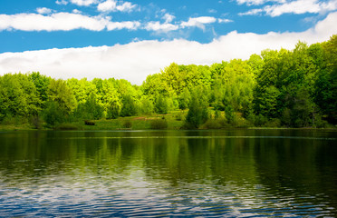 beautiful reflection of a sky in the lake. lovely nature background with abstract colorful ripples