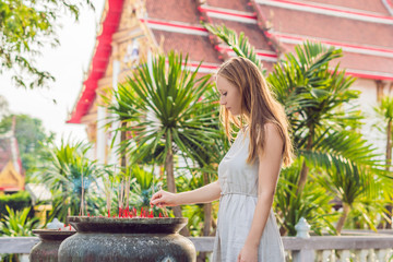 Woman tourist in the background of Thai temple Wat Chalong