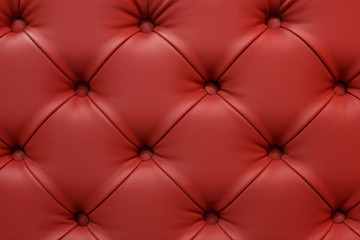 Dark red leather sofa stitched buttons.