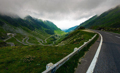 Transfagarasan road in stormy weather. dangerous driving concept. view from the side of the road