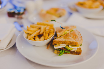 chicken sandwiches with chips and side dish bokeh