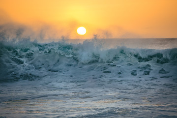 Ocean sunset and big crashing wave