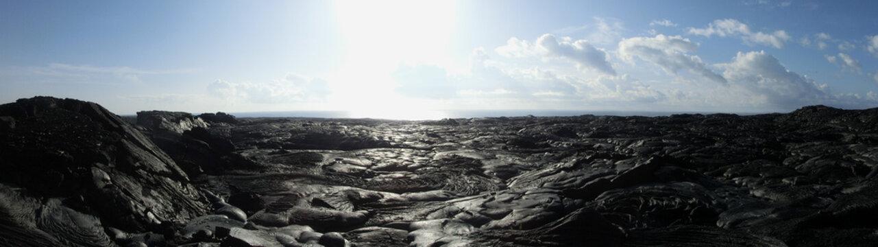 Lava field Hawaii black rock barren wasteland panoramic