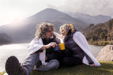 beautiful mature couple relaxing and drinking hot coffee