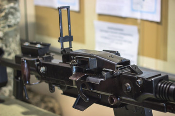 sub machine gun on the table in the interior gunsmith.