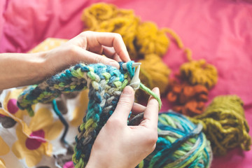 The woman knits.