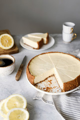 Lemon cheesecake on a table. Sliced lemon cheesecake. Selective focus