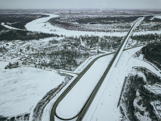 aerial top down view of the highway on a winter snowy day
