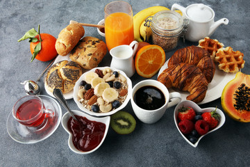 Breakfast served with coffee, orange juice, croissants and fruits. Balanced diet.