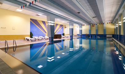 Indoors swimming pool in modern gym fitness spa
