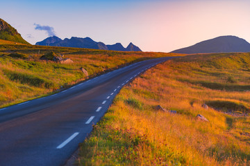 Empty road in Norway, Europe. Sunset travel
