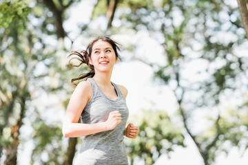 Healthy Asian woman running in the park