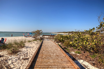 Boardwalk across the white sand beach of Delnor-Wiggins Pass State Park