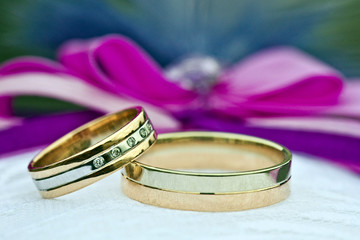 Two gold wedding rings of white and yellow gold