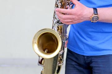 Boy playing the saxophone