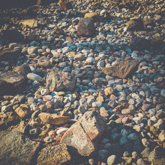 River stones in a dried up creek, nature and outdoos concept background.