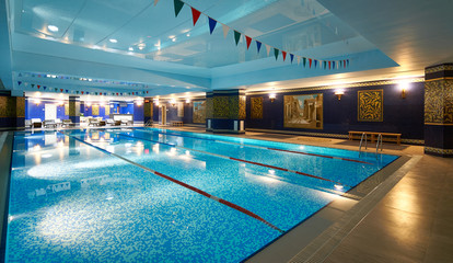 Interior of public swimming pool in a luxury fitness gym.