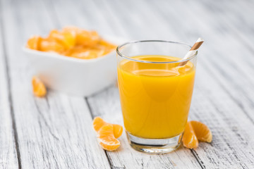 Fresh made Tangerine Juice (close-up shot)