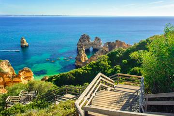 Wooden footbridge to secret beach near Lagos on Ponta da Piedade. Portugal