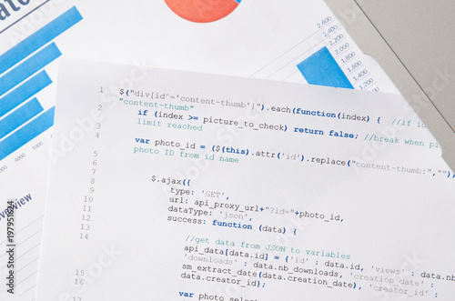 Web developer programming code printed on a piece of paper