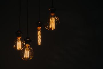 Edison vintage retro light bulb lamp lantern at dark. Art detail decor of interior