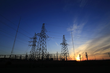 A high voltage substation in the sky at sunrise