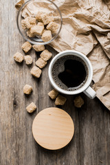Fototapete - Coffee on a wooden table