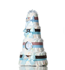 Diapers cake four leveled diaper cake with blue ribbons and bows for baby boy infant isolated