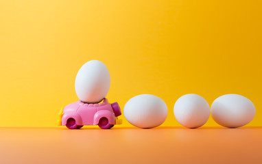 Easter egg on car with copy space for texts.Vintage  color toned for Easter concept background.