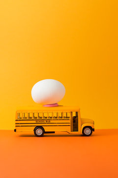 Easter egg on yellow school bus with copy space for texts.Vintage color toned for Easter concept background.