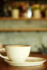 Coffee cup in coffee shop interior