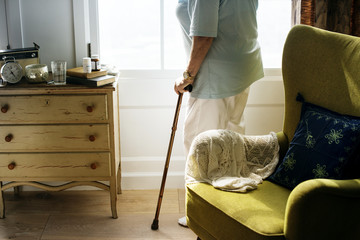 Senior woman standing alone in the room