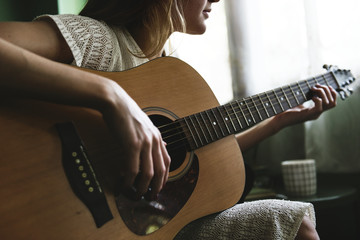 Girl playing an acoustic guitar