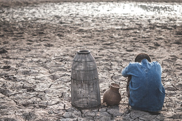 The cracked dry ground due to drought, food shortages and water,  Concept drought and crisis environment.