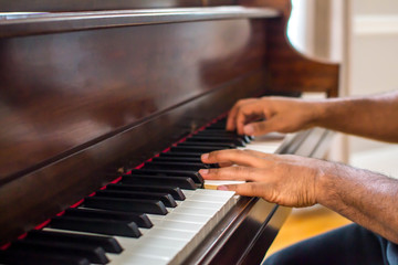 Black man playing piano