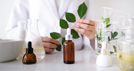 the scientist,dermatologist make the organic natural herb cosmetic product in the laboratory. beauty healthy skincare concept. herb medicine ,blank package,bottle,container.cream,serum.