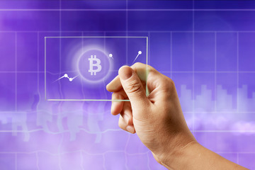 Icon bitcoin on a glass screen with a graph of crypto currency on an ultraviolet background