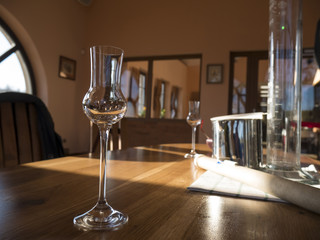 empty alcohol glass on wooden table during destilation of spirits, degustation