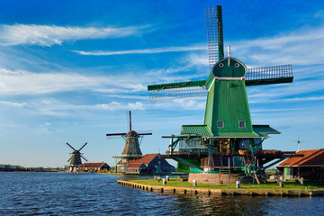 Windmills at Zaanse Schans in Holland on sunset. Zaandam, Nether Fototapete