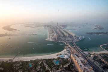 Aerial photo of The Palm Jumeirah in Dubai, UAE at dusk