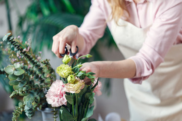 Portrait of florist woman with scissors with flowers