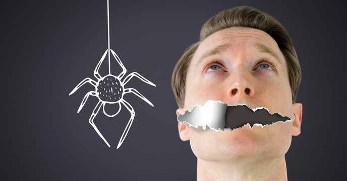 Arachnophobia fear Man with torn paper on mouth and scary spider