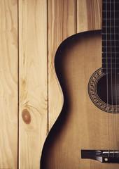 guitar on a  wooden bg  part photo